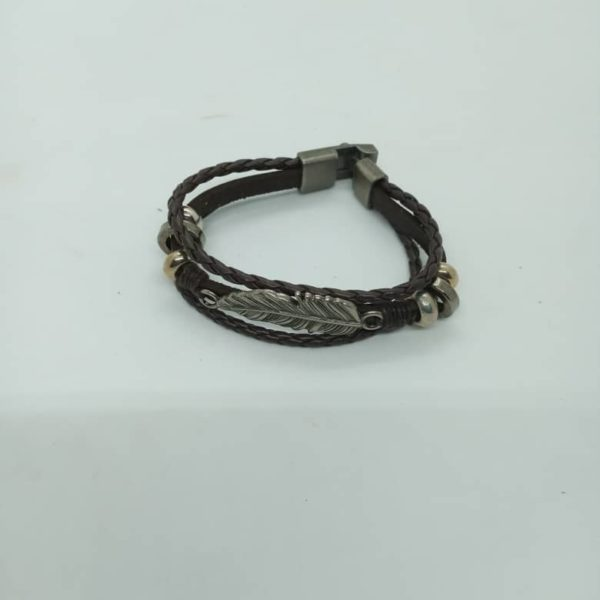 Leather bracelets with metal accessories and clasp